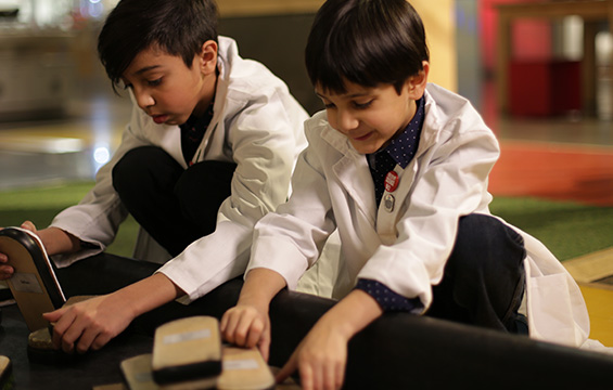 Two boys experiment with friction at the Science Centre.