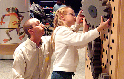 A child exploring gears in KidSpark.