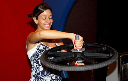 A woman learns about momentum in the Science Arcade.
