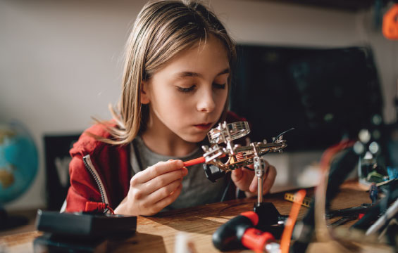 A child works on an electronics project.