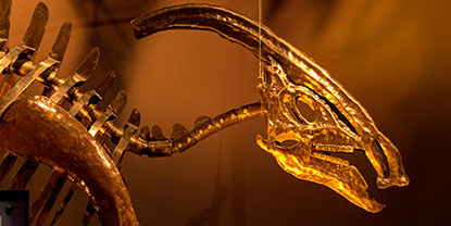 A large metal sculpture of a dinosaur.