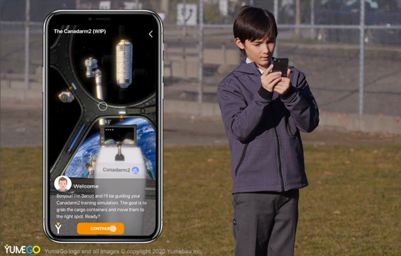 A child uses their phone outdoors to explore space in an AR experience.