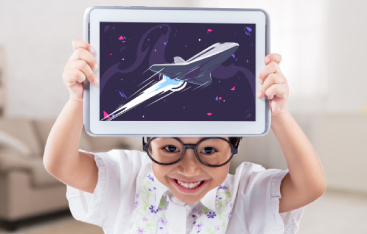 A young child holds up a tablet showing a rocket.